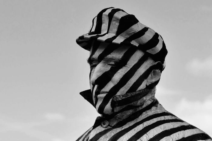 Black And White Monochrome Street Photography Walking In The Street Walking In London Outdoors Lifestyles City Life London Streets Striped Adult One Man Only Only Men Human Body Part Headshot Camouflage Clothing Take Photos Eye4photography  EyeEm Gallery City Street Captured Moment