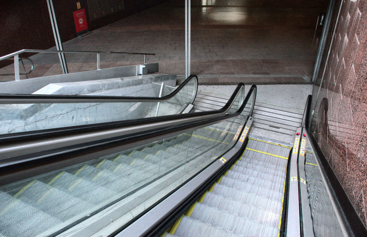 Mechanical stairs to access the Metro Mechanical Stairs Metro Public Transportation Stairs & Shadows Stairway Architecture High Angle View Metal Motion No People Outdoors Public Transportation Staircase Steps And Staircases