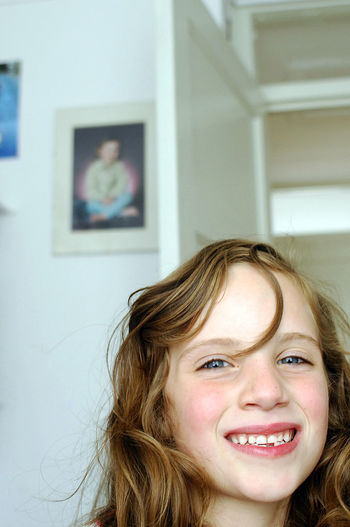 Close-Up Portrait Of Cheerful Girl