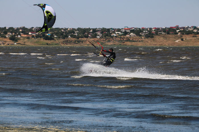 Adventure Day Enjoyment Extreme Sports Fun Jumping Kitesurfing Leisure Activity Lifestyles Mid-air Motion Nature Scud Skill  Splash Sport Summer Summertime Tourist Vacations Water Wave