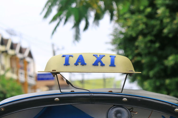 Close-up of taxi sign on car roof