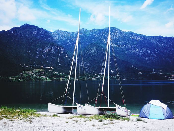 Water Lake Outdoors No People Sky Nautical Vessel Mountain Tranquility Cloud - Sky Landscape Nature Scenics Day Sailboat Tree Beauty In Nature