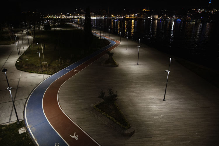 Illuminated City Architecture Night High Angle View Transportation Street Built Structure Building Exterior No People Road Water Street Light Symbol Nature Lighting Equipment Outdoors Direction The Way Forward The Art Of Street Photography