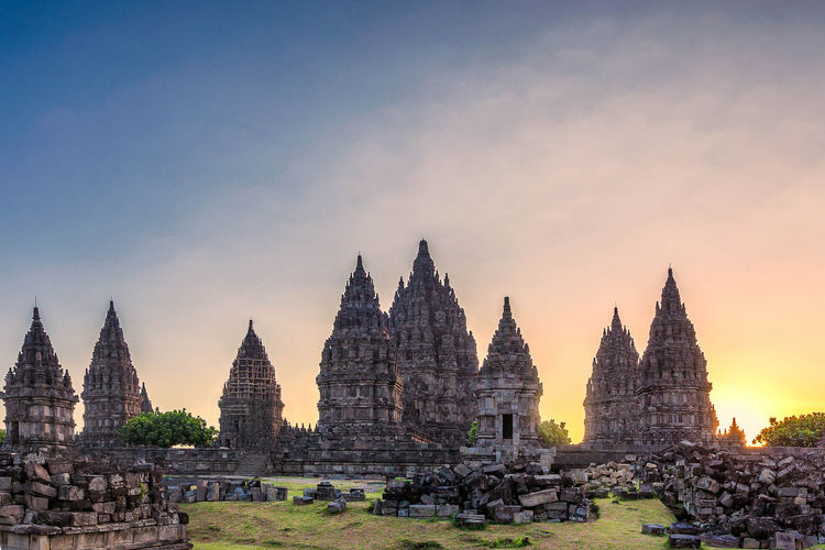 Ancient Architecture Buddhism Building Exterior Built Structure Cultures Day History INDONESIA No People Outdoors Place Of Worship Prambanan Religion Ruins Sky Spirituality Sunset Sunsets Tourism Travel Travel Destinations Tree Yogyakarta