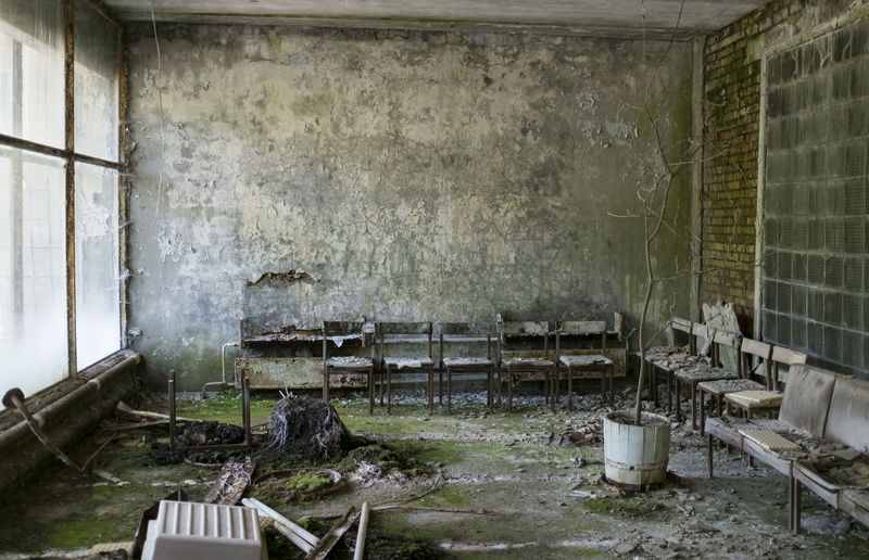 Chairs in abandoned interior