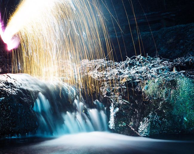 Happy New Year 2017! Long Exposure Motion Blurred Motion Beauty In Nature Waterfall Flowing Water Night Multi Colored Cold Temperature New Year Light Firework Sparks Spark Flowing Water Blurry Nature River Outdoors Little Stars No People Speed Fire Fireworks