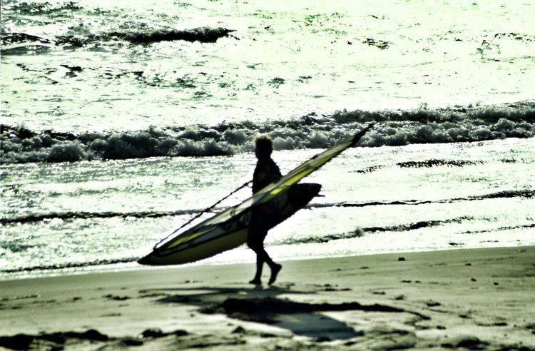 Wind surfer walking on beach Color Color Photography Editorial  Surfing Surf Surfer Surf Photography Surfers Surfer Dude Beach Ocean Oceanside Editorial  California America Windsurfer Wind Surfing Wind Surfer Wind Surf Silouette