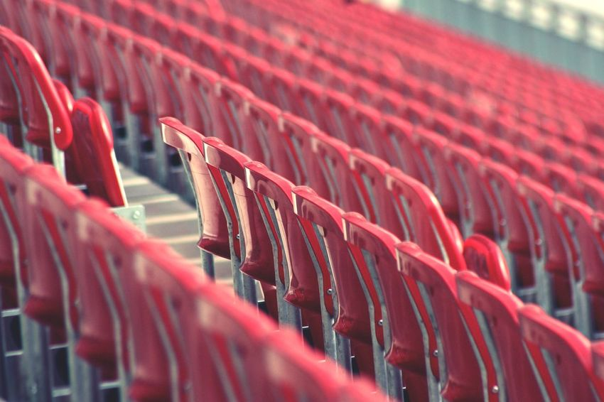 Red Selective Focus No People Close-up Sport Seats Available Seats STAND Red And Gray Soccer Stadium Seat In A Row Spectator