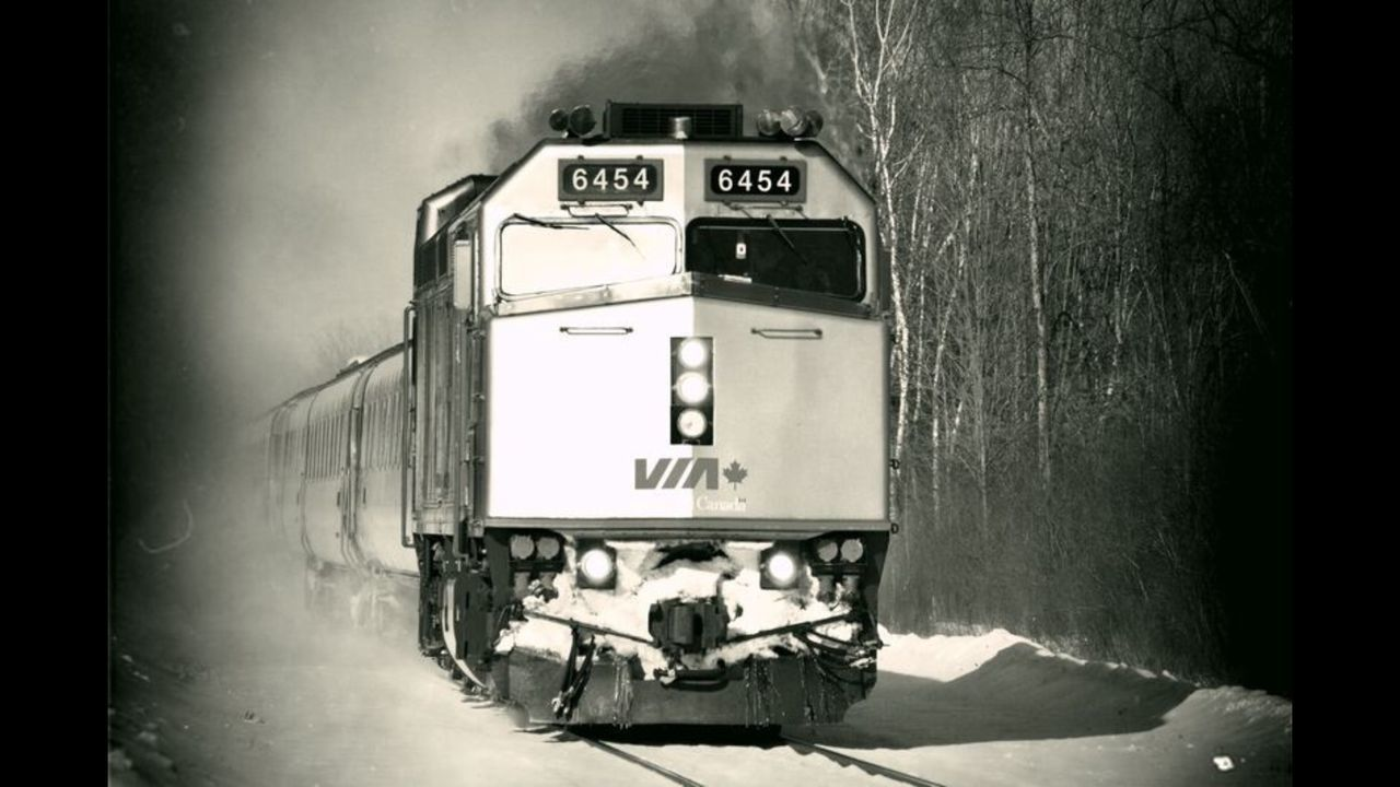 INFORMATION SIGN ON SNOW COVERED CAR