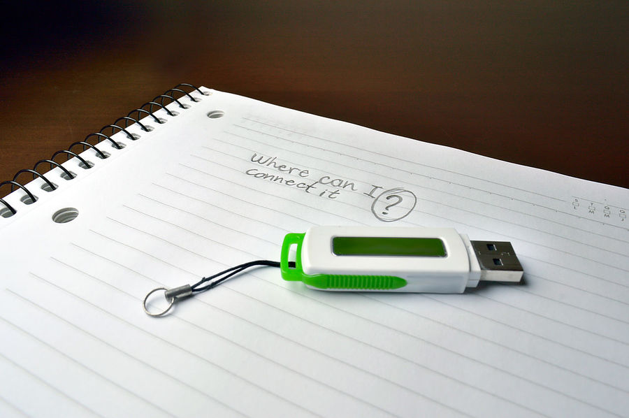 Notebook with a pen drive over ir and a message Close-up Communication Connection Failed Evolution  Generations High Angle View Old Vs New Thechnology Paper Pen Drive Spiral Notebook Table Technology Vintage