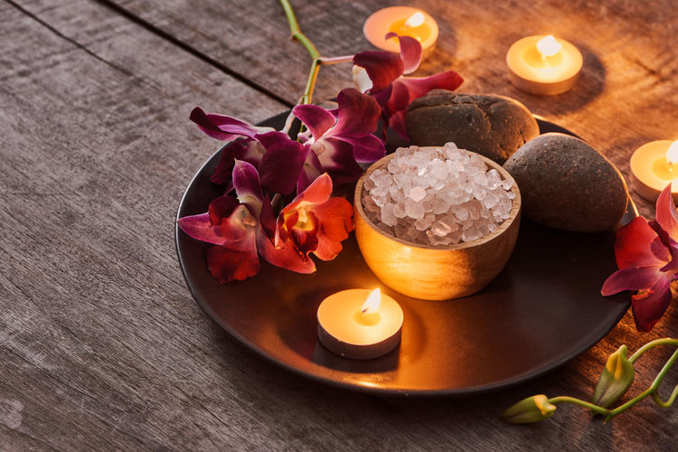 Healhty Skin. Spa Concept. Aromatherapy Beauty Beauty In Nature Candle Close-up Flower Flowering Plant Freshness High Angle View Indoors  Nature No People Petal Plant Purple Skin Care Skincare Spa Still Life Table Tea Light Wellbeing Wood - Material