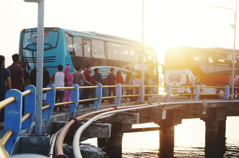 Commercial Dock Busy Bus Lens Flare Sunlight Mode Of Transport EyeEmNewHere Social Gathering Happiness walk Sea Sunset Clear Sky Outdoors Sky Day People Adult Adults Only
