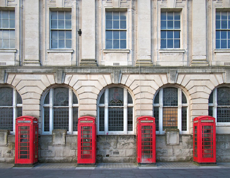 row of four red british phone boxes outside the former post office in blackpool england Blackpool British Red Phone Boxes Arch Architecture British Phone Box Building City England Façade History In A Row Phone Box Post Office Window