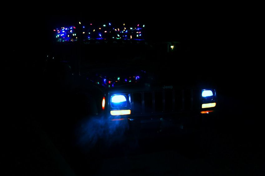 Jeep. Illuminated Night Dark Road Blue Outdoors Darkness Christmaslights Christmaslighting Jeep Jeep Life Jeepcherokee No People Lit Multi Colored Lifestyles Photography Fun Check This Out Taking Photos Carefree Smoke