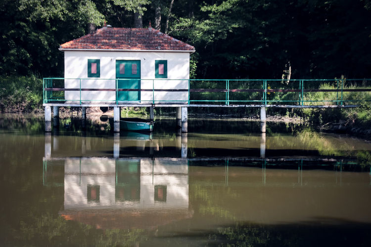 Houses Architecture Bridge Building Building Exterior Built Structure Day House Lake Nature No People Outdoors Plant Pontoon Reflection Tranquility Transportation Tree Water Waterfront