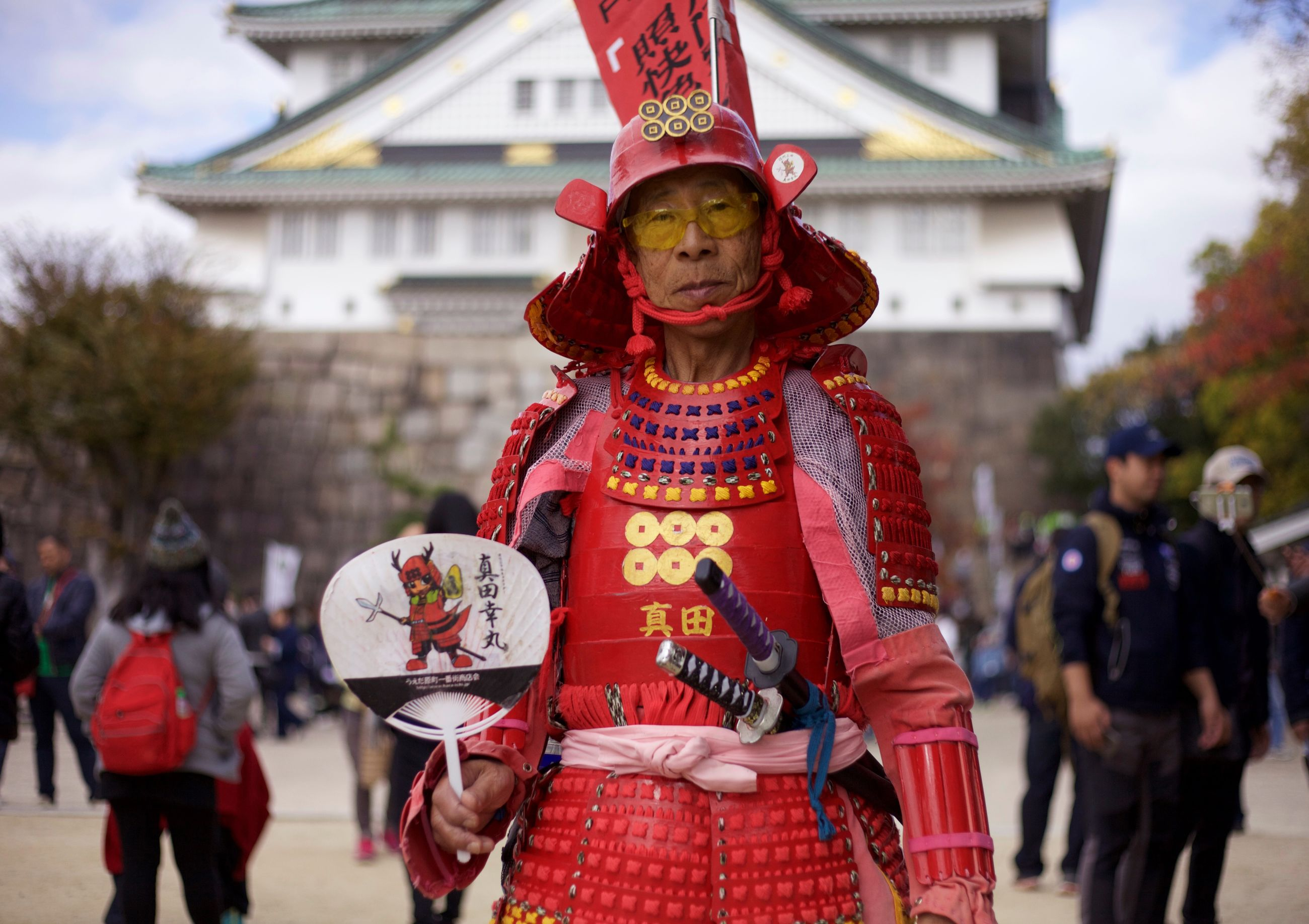 cultures, celebration, costume, mask - disguise, real people, tradition, focus on foreground, day, traditional festival, traditional dancing, outdoors, men, women, stage costume, chinese dragon