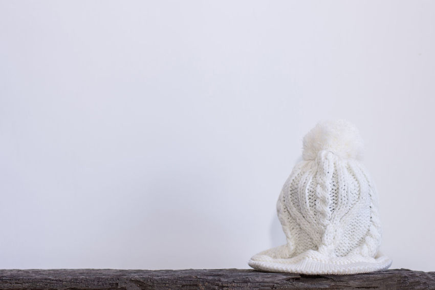 wool hat is placed on a wooden floor Close-up Copy Space Day Happy New Year No People Outdoors White Background Wool Wool Hat