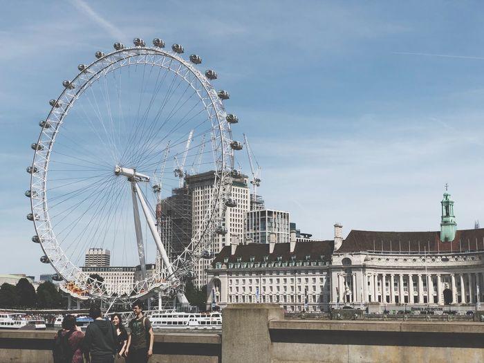 Friends Standing Against London Eye In City