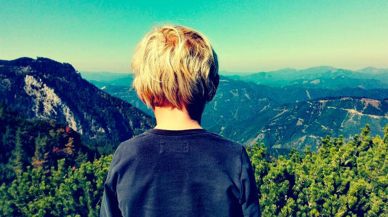 Sehn-sucht. Hiking Beauty In Nature Blond Hair Boy Child Clear Sky Day Headshot Hikingadventures Kid Landscape Looking At View Mountain Mountain Range Nature One Boy Only One Person Outdoors Real People Rear View Scenics Seek Seeking Sky Standing