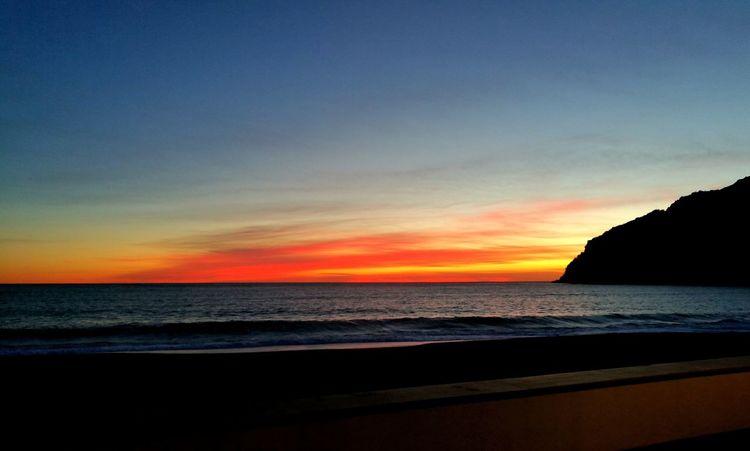 tramonti liguri 5 Terre Red Light Eyemphotography Sea Beach Horizon Over Water Scenics Nature Tranquility Sunset No People Sky Landscape Outdoors Travel Destinations