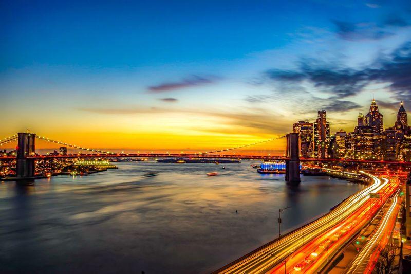 City View  Light Up Colorful Light Trail Light Skyscraper East River Manhattan Brooklyn Bridge / New York New York City Landscape Magic Hour Sky Illuminated Built Structure Water Architecture Transportation Cloud - Sky