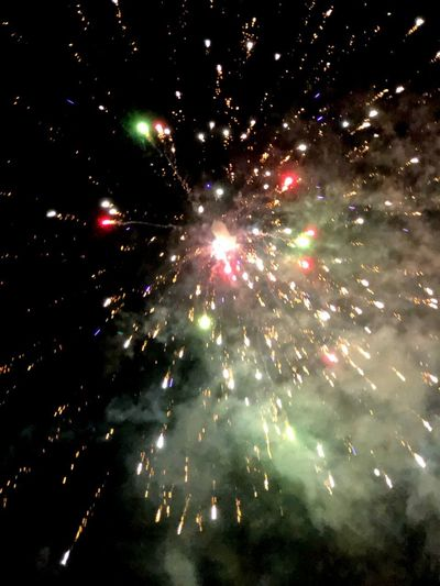 New year's firework New Year New Year's Eve Fireworks Night Firework Display Celebration Exploding Firework - Man Made Object Event Low Angle View Glowing Arts Culture And Entertainment No People Motion Firework Multi Colored Outdoors Smoke - Physical Structure Celebration Event Sky