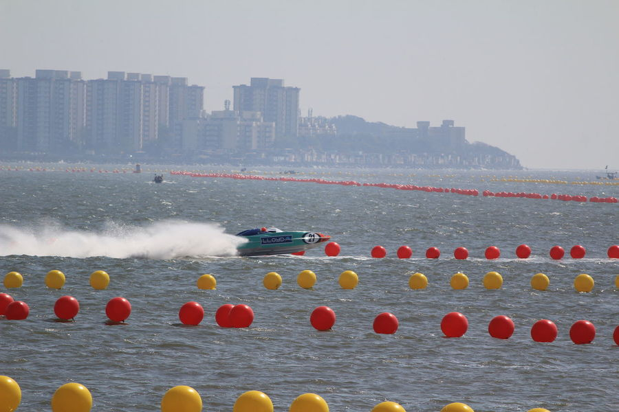 Business Finance And Industry Race Boat Race  Power Boats Boat Water Sports Boats Modern No People Water Sports Race Transportation Outdoors Speed Splash Sea Nautical Vessel City Textured  Day