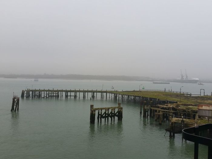 Southampton Docks United Kingdom Beauty In Nature Built Structure Day Docks Dockside Fog Foggy Nature No People Outdoors Pier Port Scenics Sea Ship Sky Southampton Tranquil Scene Tranquility Water