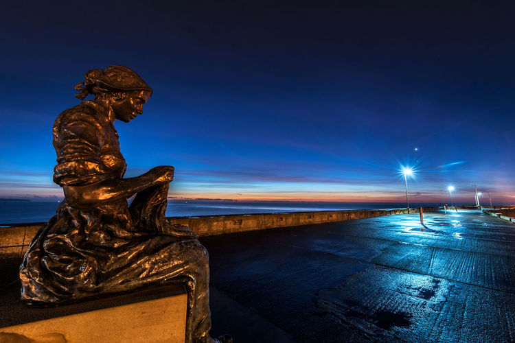 the fishermens wife Sculpture Art And Craft Statue Representation Sky Human Representation Blue Creativity Architecture Craft Water No People Nature Male Likeness History Dusk Cloud - Sky Travel Destinations City