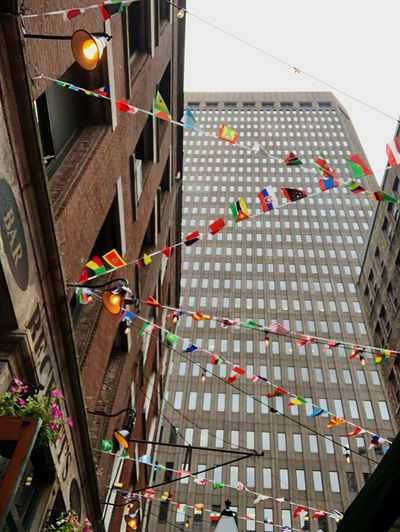 On the street Architecture Built Structure Building Exterior Hanging Celebration Decoration Multi Colored No People Nature Outdoors City Lighting Equipment Event Sky Building Bunting Flag Low Angle View Festival