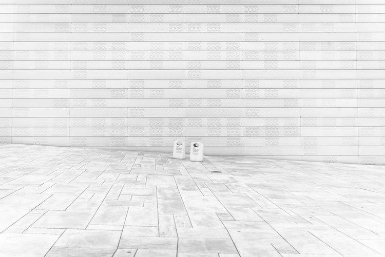 Text on tiled floor