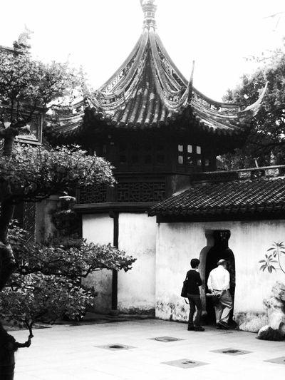 Men outside temple against building
