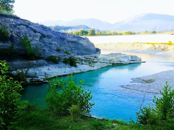 river Water Lake Sky Rocky Mountains Countryside Scenics Non-urban Scene Rock Formation Tranquil Scene Calm Tranquility Shore Idyllic