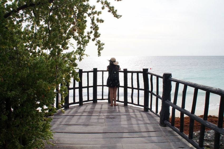 Sea Horizon Over Water Railing Water One Person Nature Full Length Scenics Tranquil Scene Tree Beauty In Nature Standing Outdoors Clear Sky Real People Sky Day Adult People Walking Around From Where I Stand Travel Destinations Tulum , Rivera Maya. Mexico