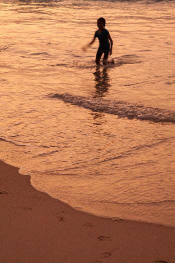 Kid Playing In Sea
