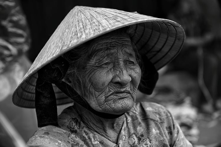 Senior Woman Wearing Asian Style Conical Hat