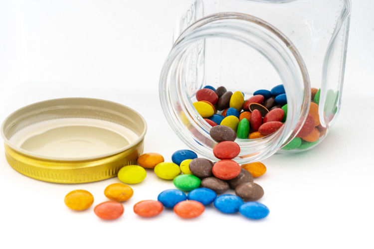 Close-up of multi colored candies in glass container