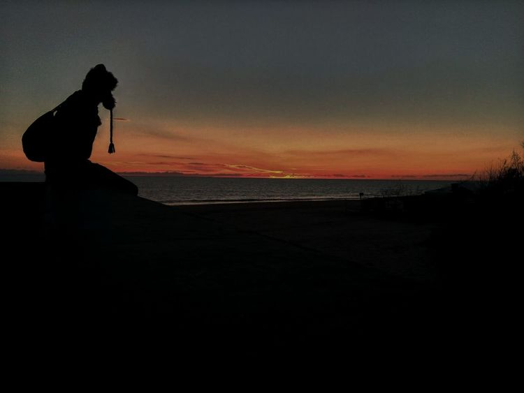 Water Silhouette Sunset One Person Full Length Dark Night Adult People Only Women Sea Beach Outdoors Women One Woman Only Adults Only Beauty In Nature Horizon Over Water Sky Nature Musician