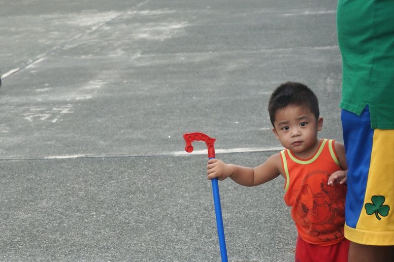 View of boy holding toy