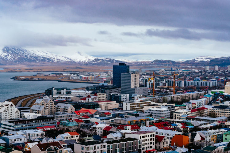 Architecture Building Exterior Built Structure City Cityscape Cloud Cloud - Sky Cloudy Crowded High Angle View Iceland Island Mountain Mountain Range Residential Building Residential District Residential Structure Reykjavik River Sea Sky Town Water