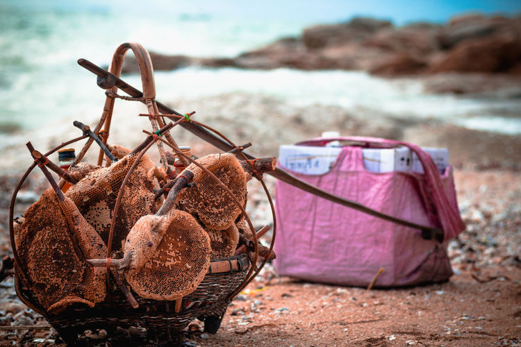 Close-up of wicker basket on shore