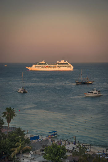 A cruise ship at anchor in the bay at Cabo San Lucas, Baja California, Mexico. Mexico Los Cabos Los Cabos, Mexico Cabo San Lucas Baja California Sur Town Vacations Destination Holiday Sea Horizon Over Water Cruise Ship Pacific Ocean Sea Of Cortez Nautical Vessel Ship No People Sky Water Large Ship Cruising Ocean Passenger Ship Transportation Scenics - Nature