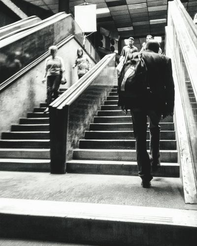 Steps And Staircases Staircase Steps One Person Railing Full Length Walking Men Real People High Angle View One Man Only Adults Only Adult People Lifestyles Day Only Men Architecture Indoors  City The Street Photographer - 2017 EyeEm Awards