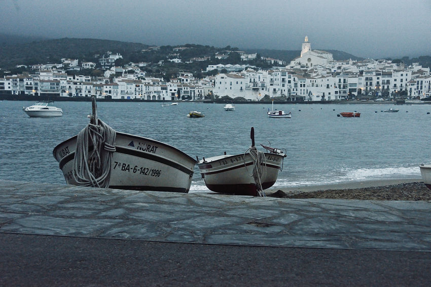 two boats on the beach with Cadaques on the background in winter Boat Cadaqués Costa Brava Harbor Landscape Nautical Vessel No People Outdoors Sea SPAIN Water Winter Wintertime Travel Pictures Waterfrontview