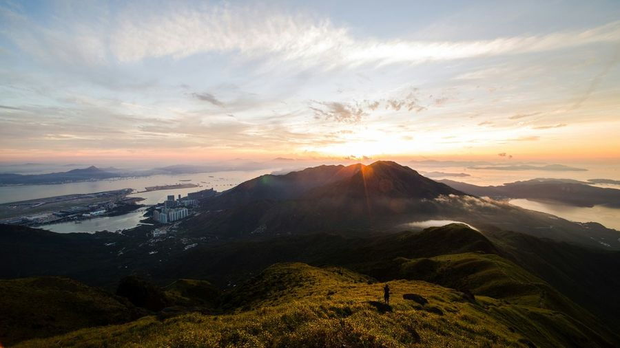 Scenic View Of Lantau Peak Against Sky During Sunset