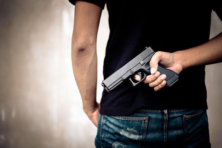 Gun Violate Adult Close-up Crime Gun Hand Handgun Handguns Hide Holding Human Body Part Human Hand Men Midsection One Person Outdoors People Pistol Robber Terror Terrorism Terrorist Thief Weapon