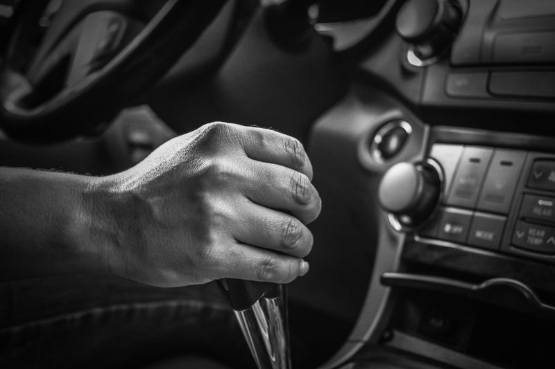 Cropped image of hand holding gearshift