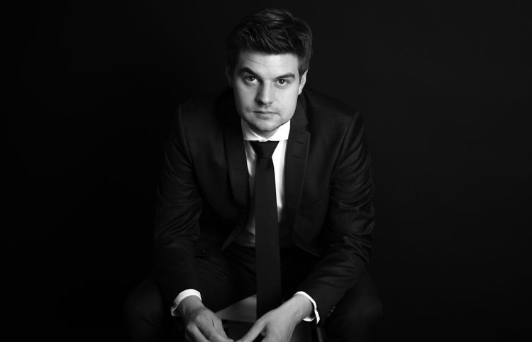 Adult Beautiful People Black Background Black Color Cool Attitude Fashion Fashion Model Handsome Human Body Part Individuality Looking Macho Males  Men Modern One Man Only One Person Only Men People Portrait Suave Suit Well-dressed Young Adult