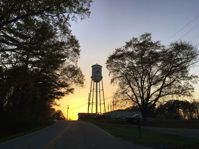 Paint The Town Yellow Storage Tank Water Tower - Storage Tank Silhouette Road Water Tank No People Sunset Architecture Outdoors Sky Nature Yellow Color