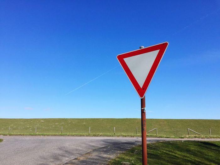 Dike Landscape Intersection Traffic Sign Sky Minimalism